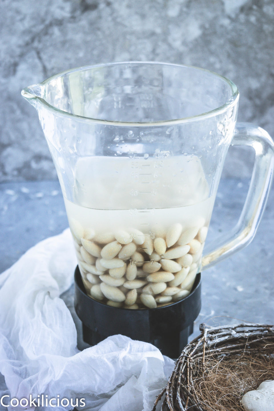 image of a blender filled with almonds & water to make Almond Milk
