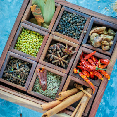 a masala box filled with dry spices used to make garam masala