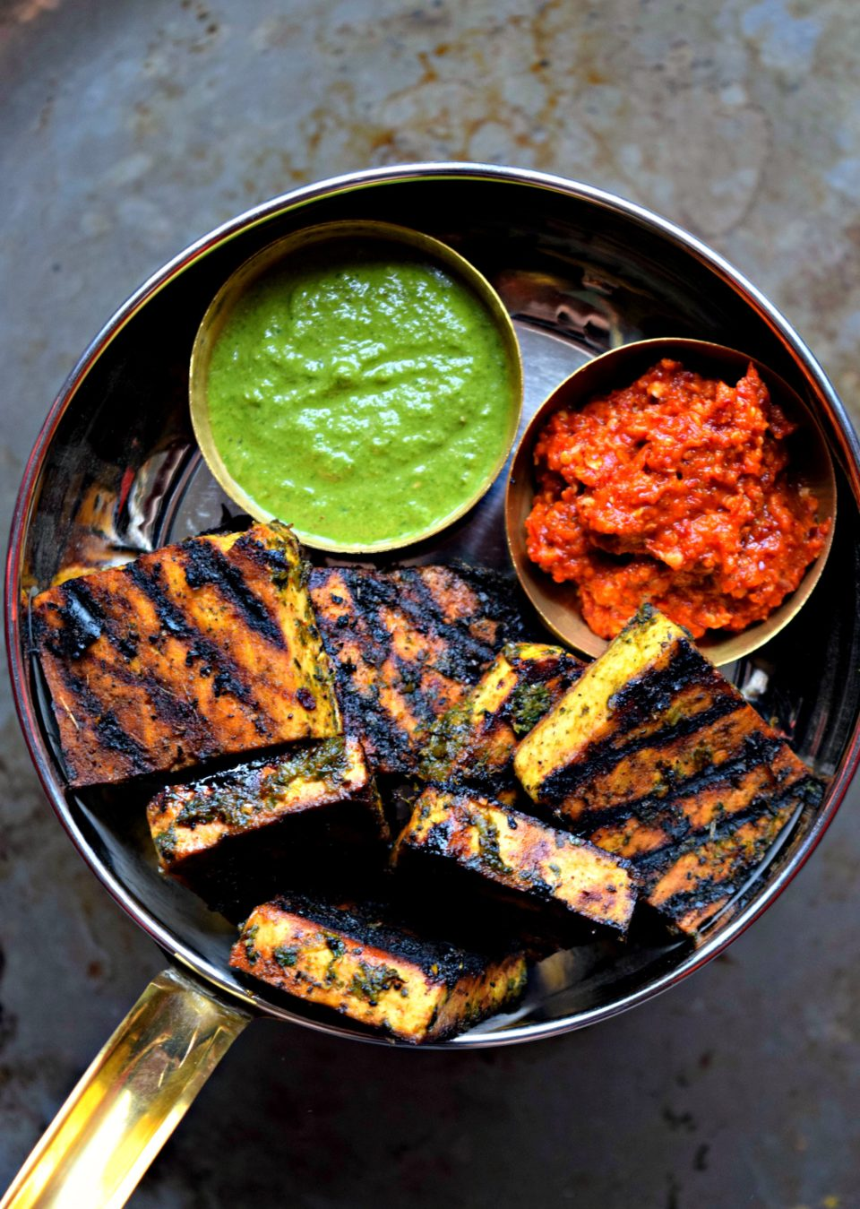 A delicious snack for Summer! Grilled tofu is marinated with basil & garlic sauce & served with chutney. Loaded with proteins, this grilled dish is yummy!