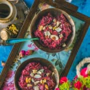 2 bowls of Beetroot Halwa served in a tray with spoons in them