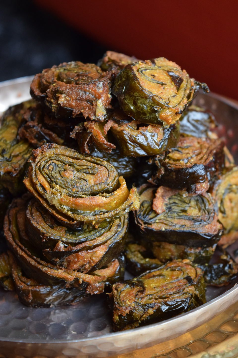 Pathrode is a traditional snack recipe from coastal Karnataka in India. Colacassia leaf is smeared with spiced lentil coating, then steamed & shallow fried.