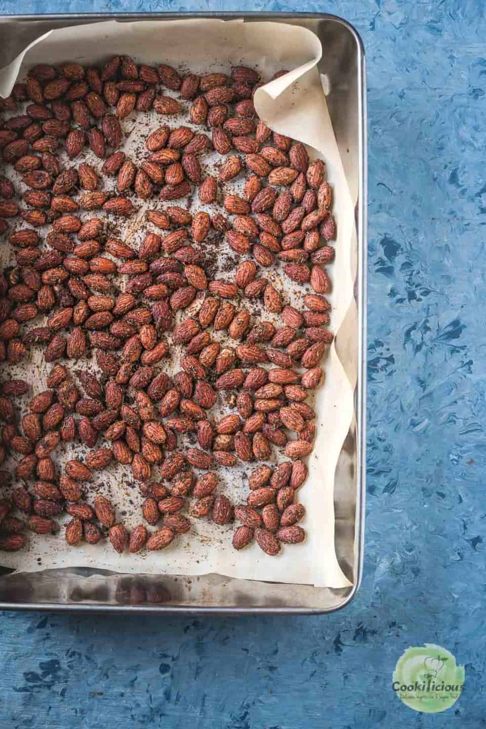 Smoky Spicy Garlic Roasted Almonds on a tray freshly out of the oven