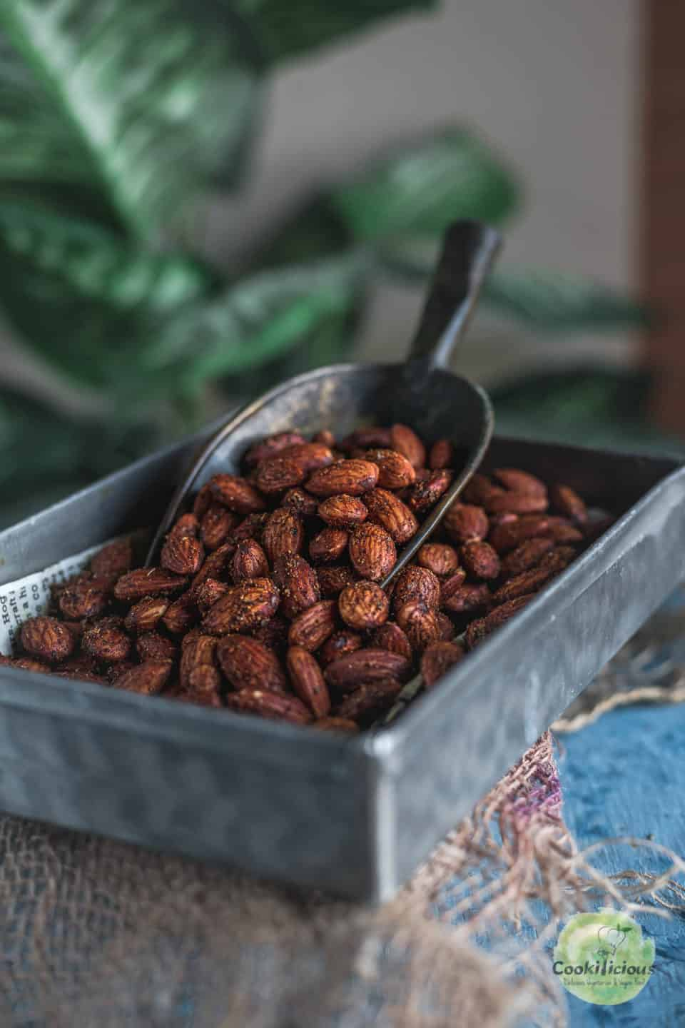 a rectangular tin filled with Smoky Spicy Garlic Roasted Almonds