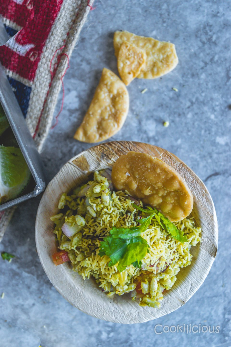 top shot of 1 bowl of bhelpuri with puri in the background