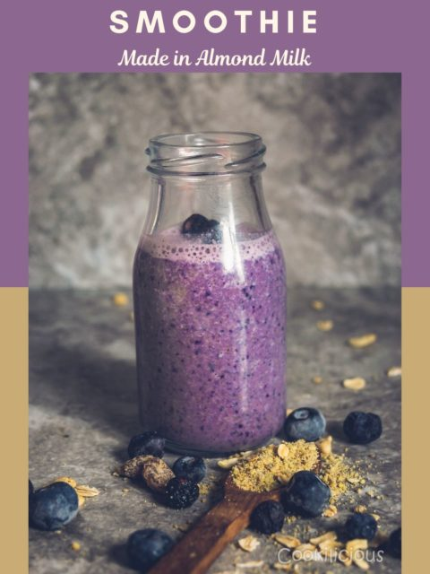 Front view of a glass filled with Vegan Blueberry Pancake Almond Milk Smoothie with text at the top