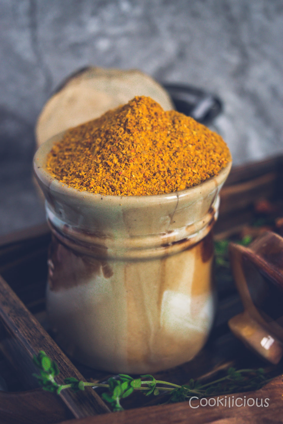 side view of the jar filled with sambhar powder