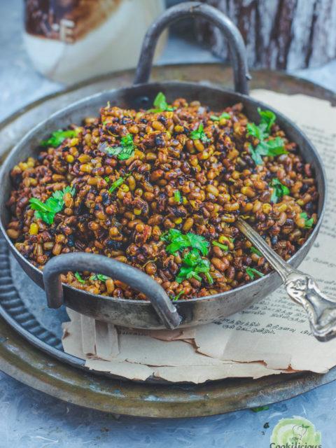 a kadai full of Vegan Matki Usal with a spoon in it