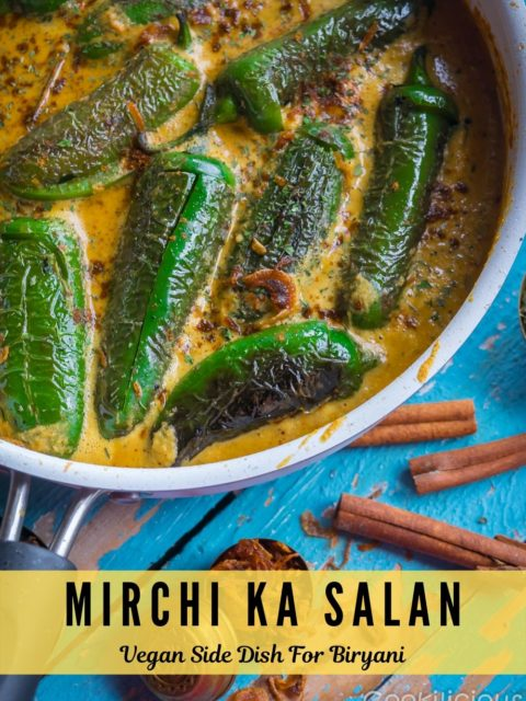 close up side shot of Mirchi Ka Salaan | Curried Chilly Peppers with cinnamon sticks in the background and text at the bottom