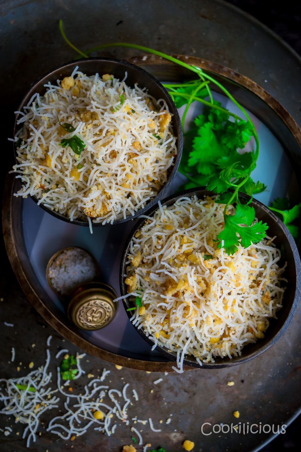 two bowls of Lentil & Rice Noodles | Paruppu Sevai in bowls placed in a round tray.