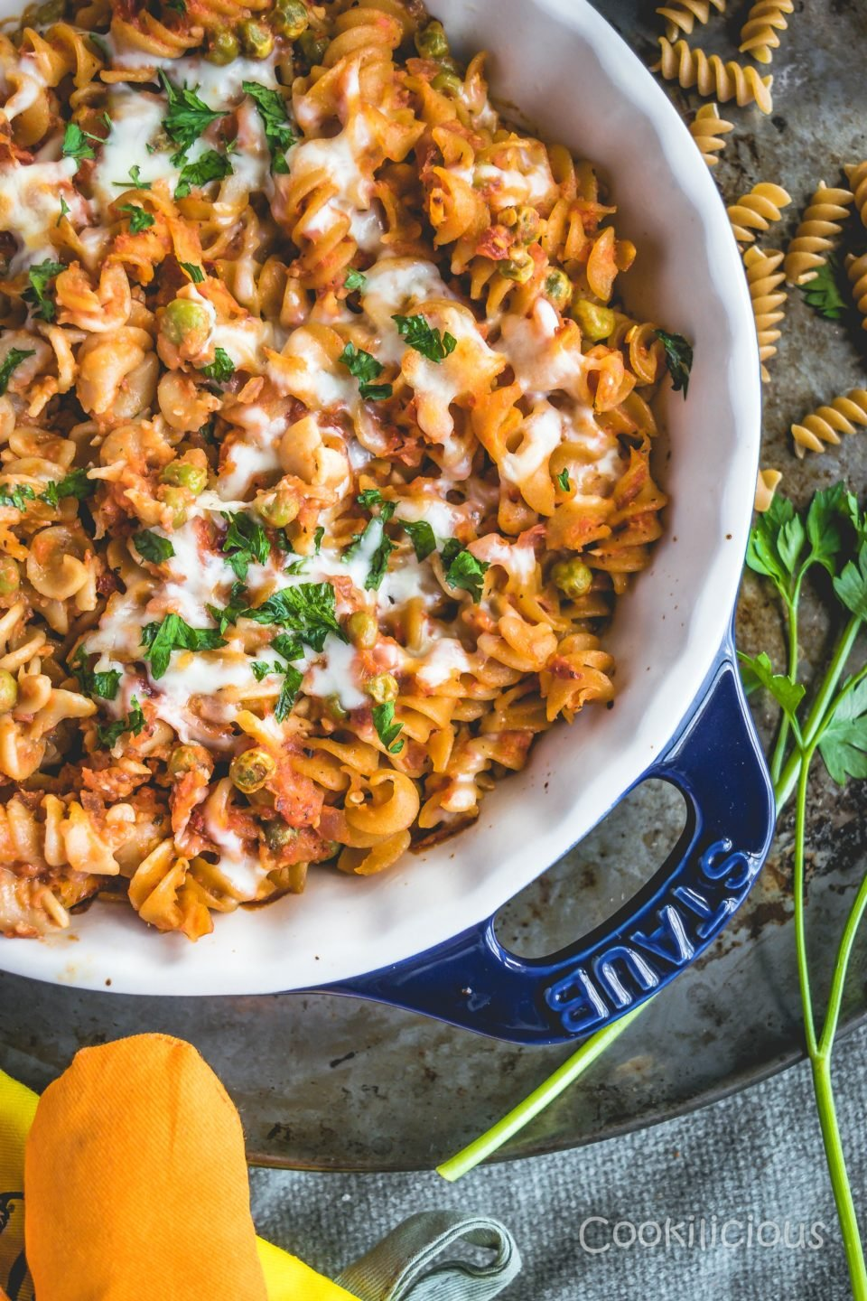 flat lay shot of a dish with Easy Cheesy Tomato Rotini Pasta Bake with grated cheese on top