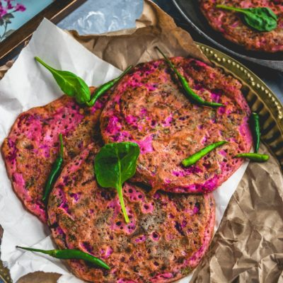 3 Pink Uttapam with Beets & Veggies over crumbled brown paper