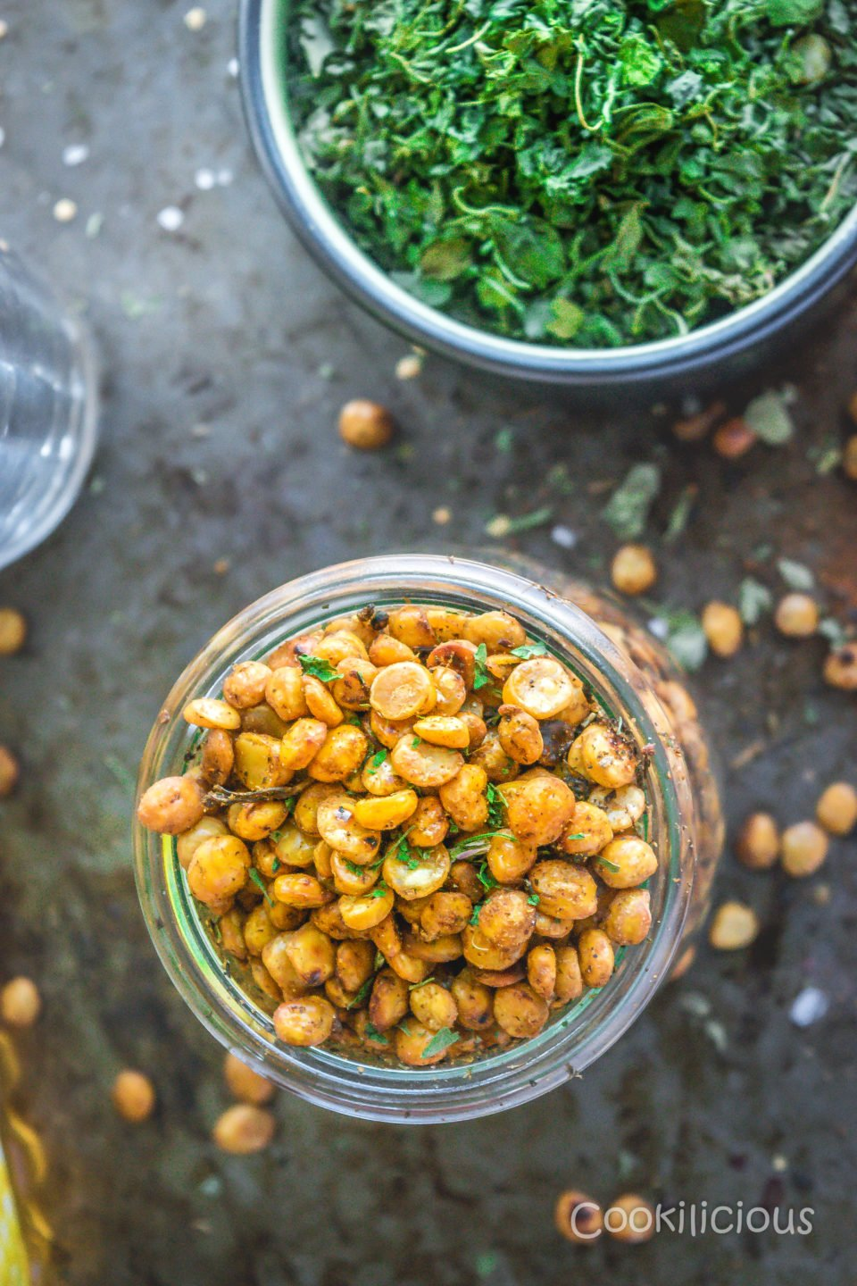 top shot close up of a jar filled with Crispy Vegan Split Peas with a bowl of kasoori methi on the side