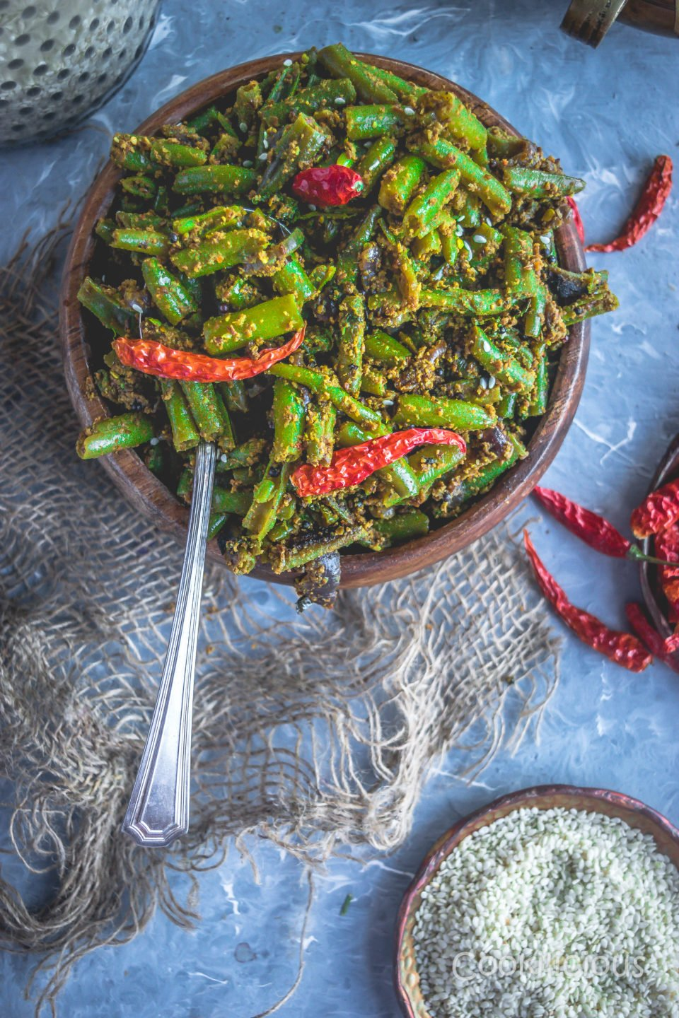 Sesame Flavored Green Beans Stir Fry in a wooden bowl with a spoon