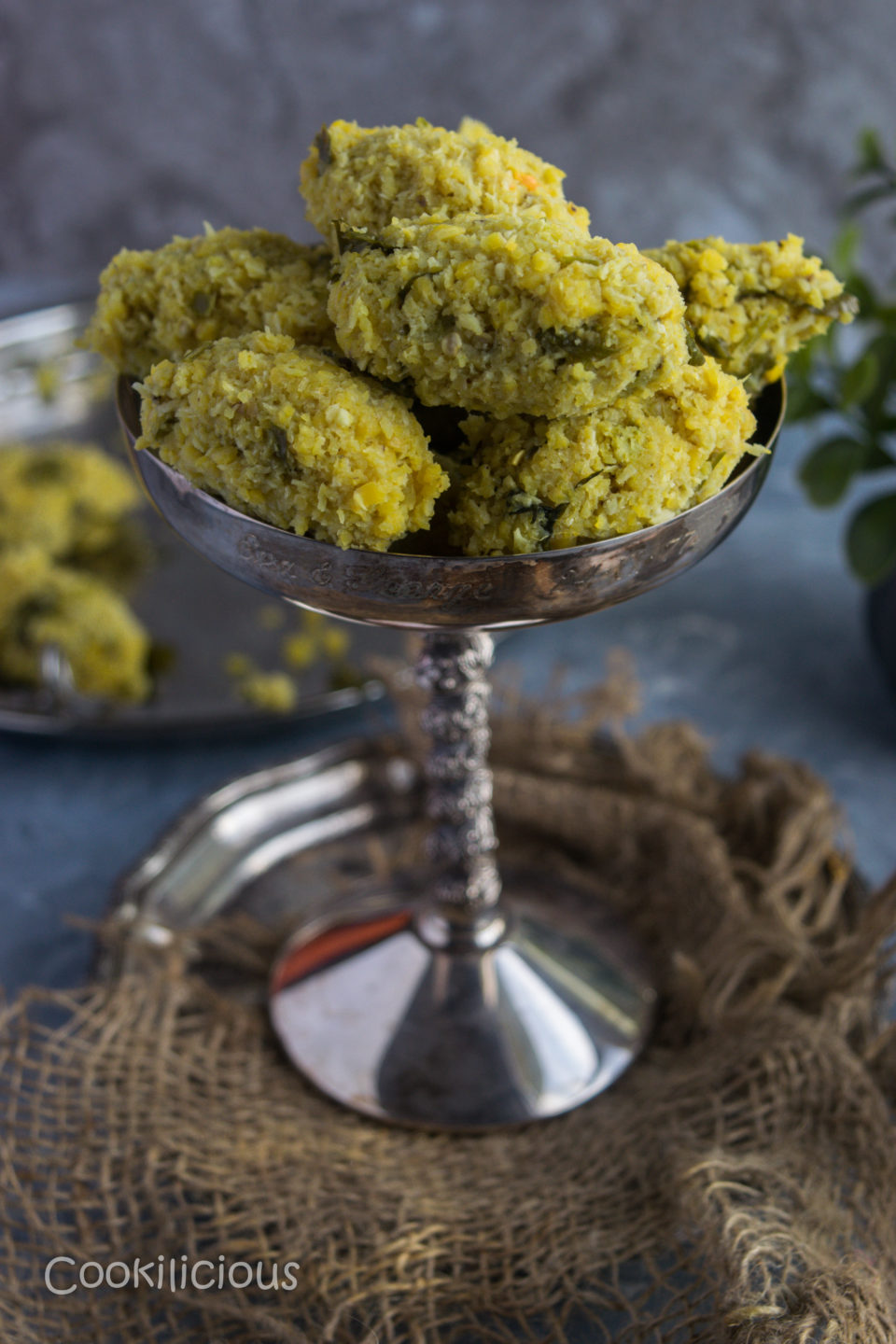 a tall glass filled with Spicy Steamed Lentil Balls