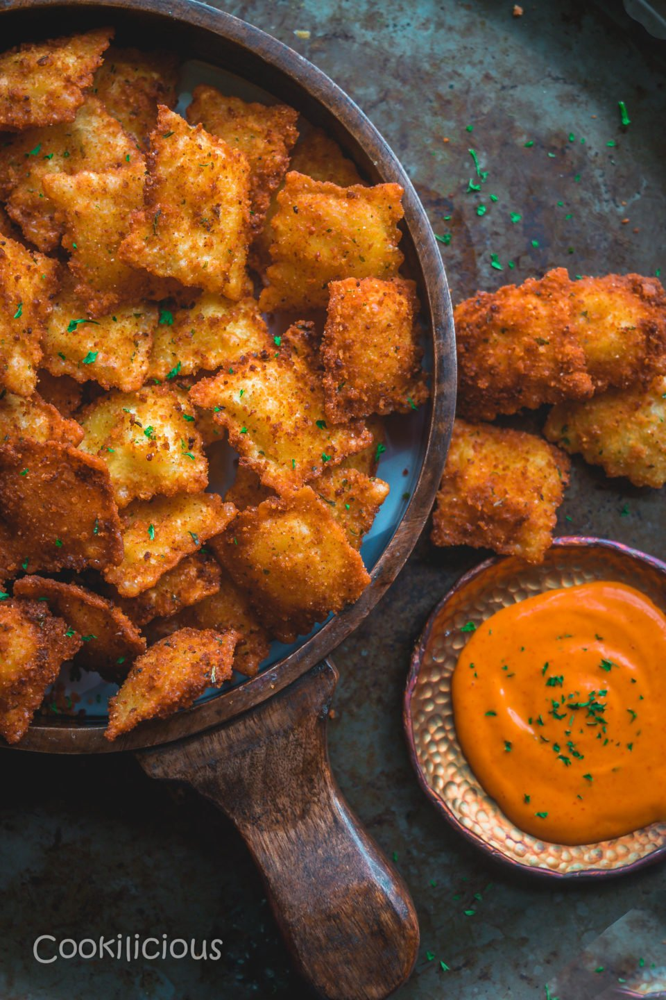 image of half a tray filled with Copycat Olive Garden Cheesy Fried Ravioli - vegan appetizer recipes