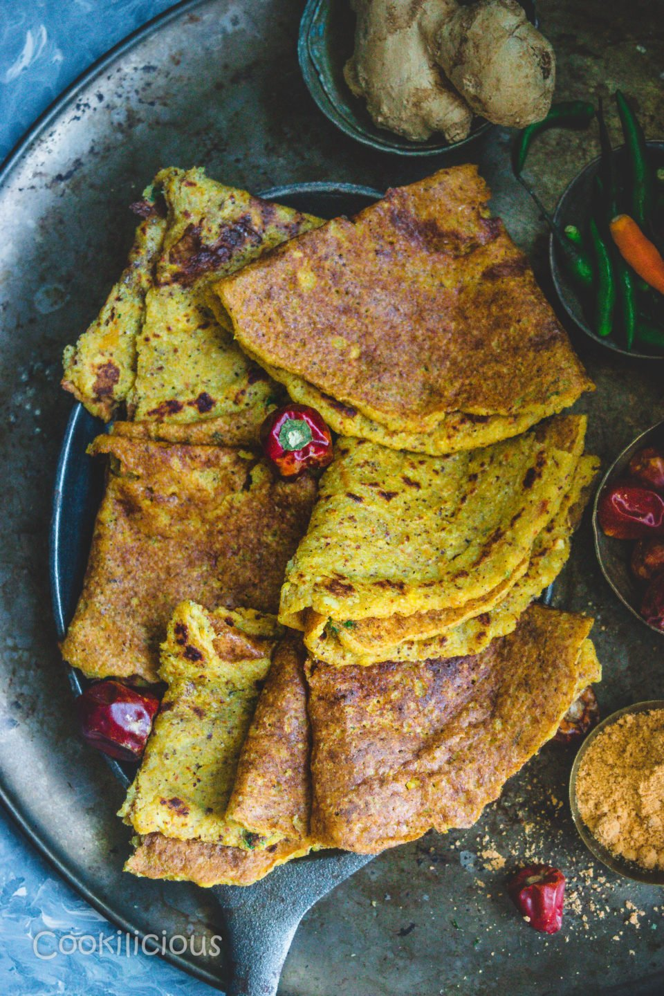 an oval tray filled with Spicy Quinoa & Red Pumpkin Adai