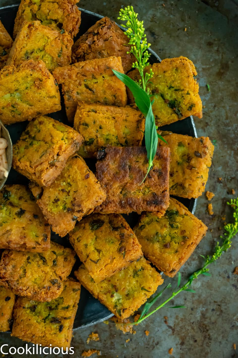 shot of half plate of Fried Besan (Chickpea Flour) & Potato Squares
