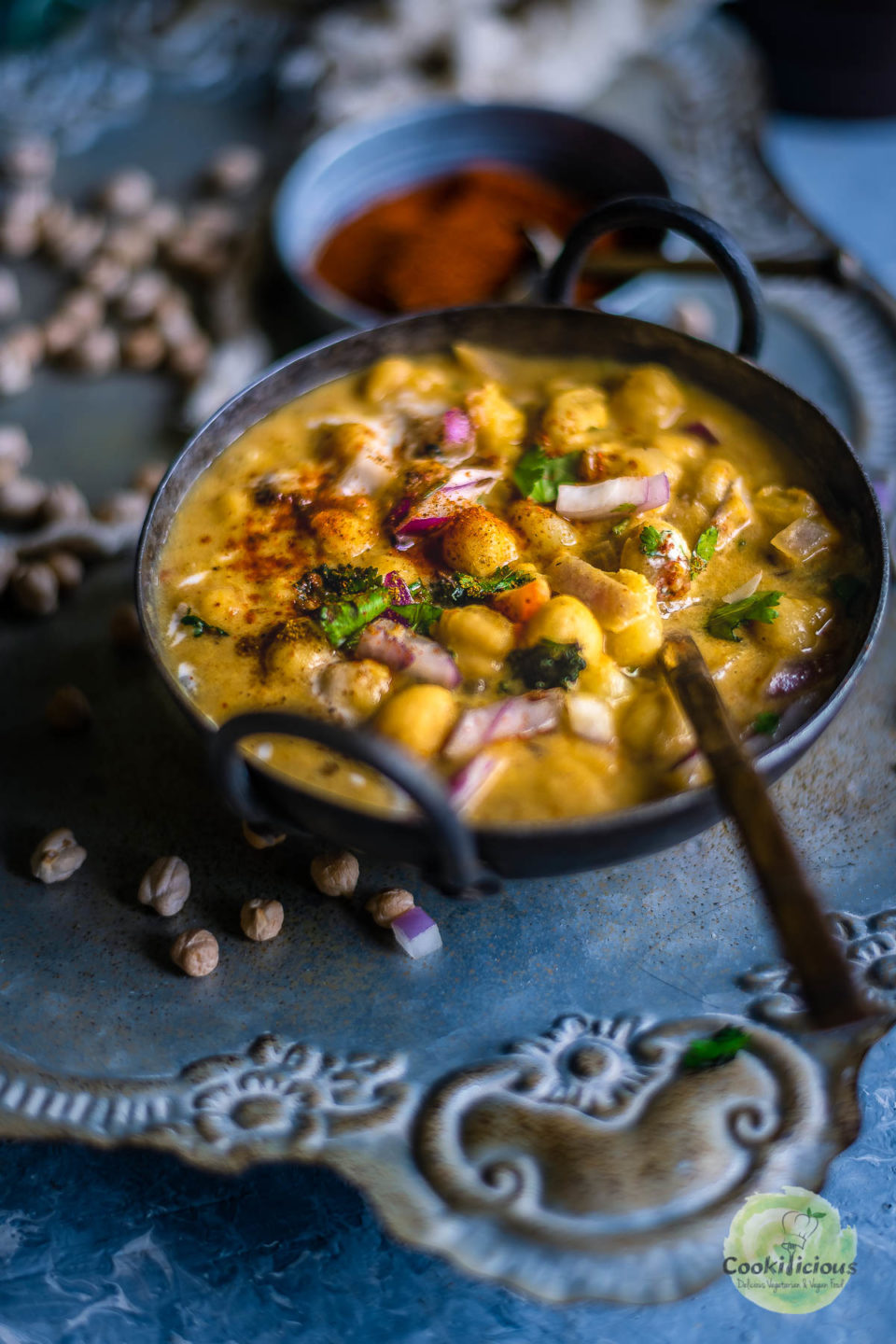 a small kadai filled with Instant Pot Potato Chickpeas Vegan Curry