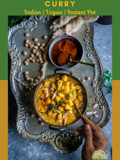 a hand holding a spoon and digging into a bowl filled with Instant Pot Potato Chickpeas Vegan Curry and text at the top