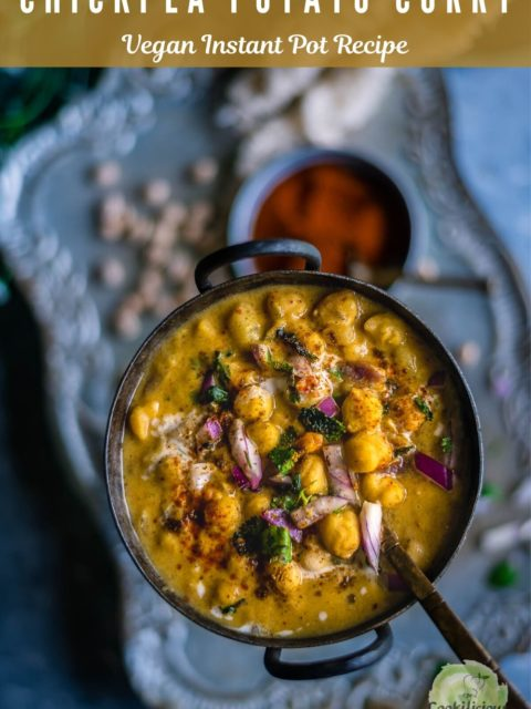 Instant Pot Potato Chickpeas Vegan Curry in a round bowl with a spoon in it and text at the top