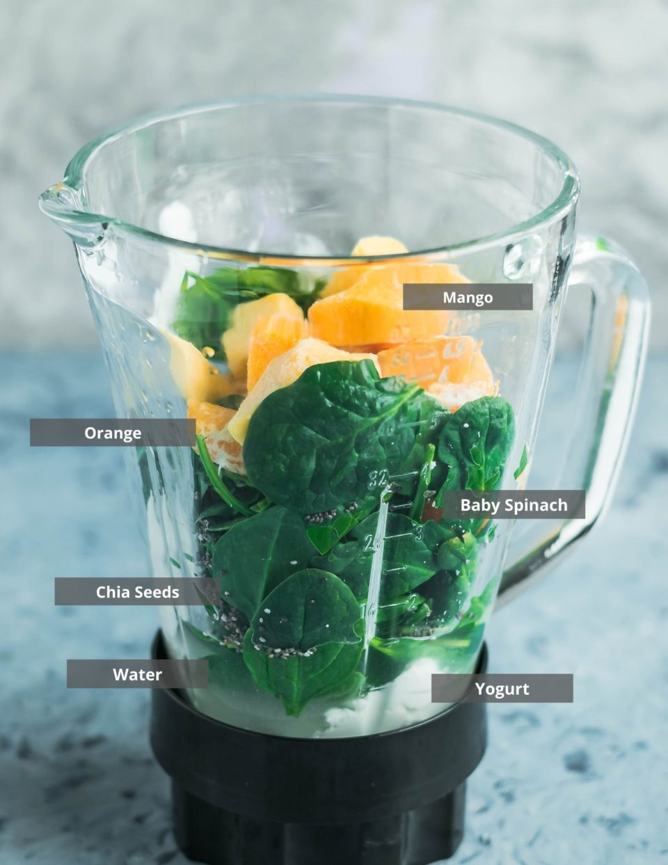 all the ingredients needed to make Mango Spinach Yogurt Green Smoothie put in a blender