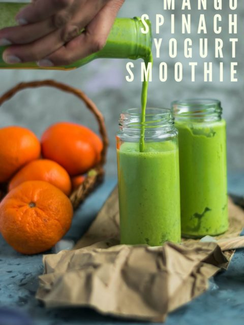 a hand holding a bottle and pouring Super Healthy Mango Spinach Yogurt Power Smoothie into a glass & text at the top