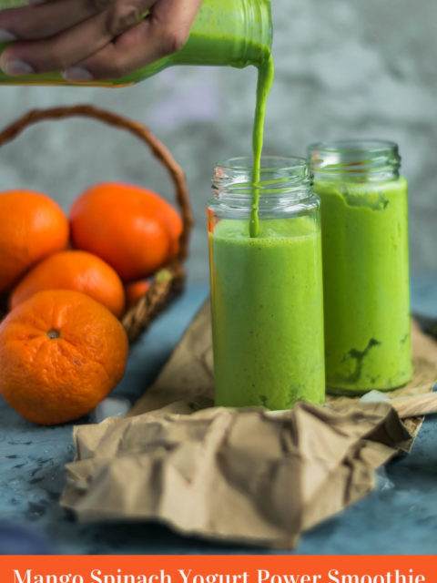 a hand holding a bottle and pouring Super Healthy Mango Spinach Yogurt Power Smoothie into a glass & text at the bottom