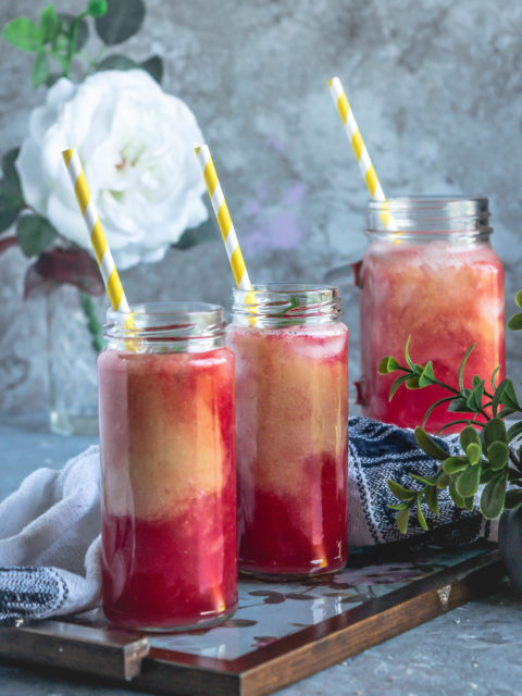 2 glasses of Fresh Guava & Watermelon Non Boozy Summer Drink with straw in it