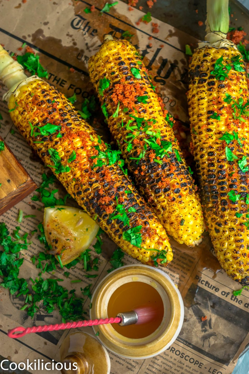 3 Indian Street Style Corn On The Cob placed in a platter
