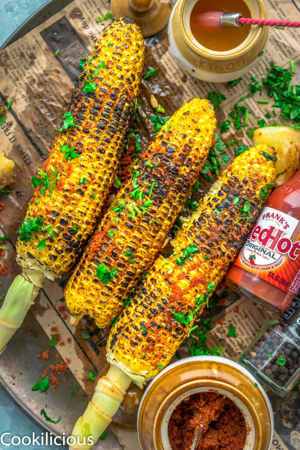 top angle shot of 3 Indian Street Style Corn On The Cob