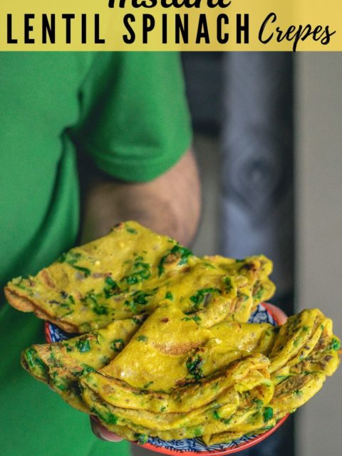 a man holding a a plate full of Moong Dal & Palak Chilla and text at the top