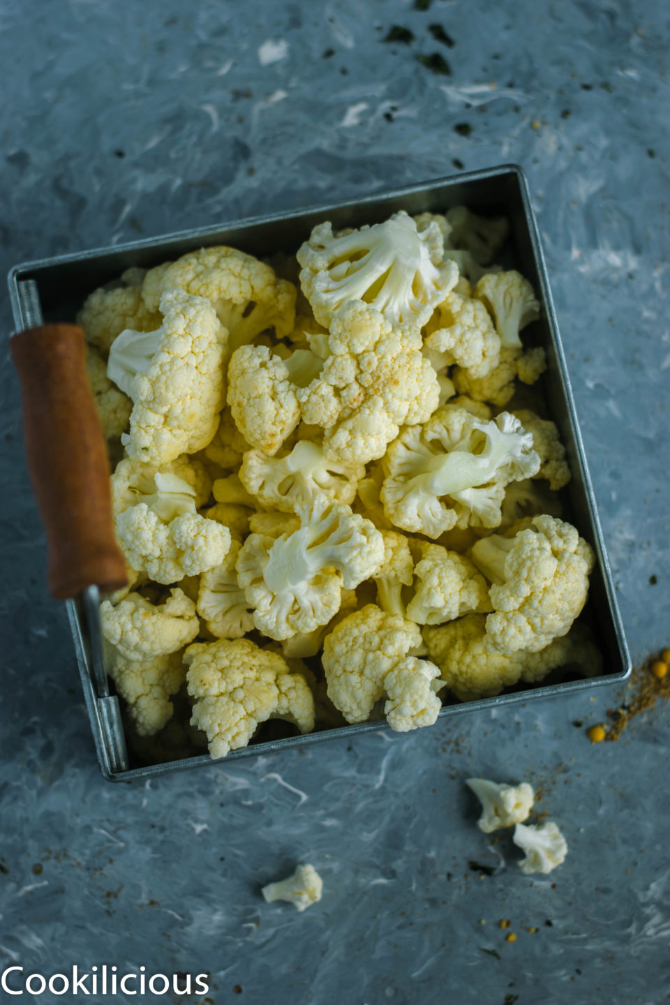 cauliflower florets in a dish used to make Indian cauliflower curry