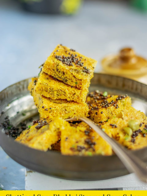 3 Corn Dhokla resting on a spoon and text at the bottom with the recipe name