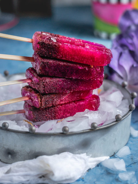 Masala Soda Blueberry Popsicles placed one on top of the other