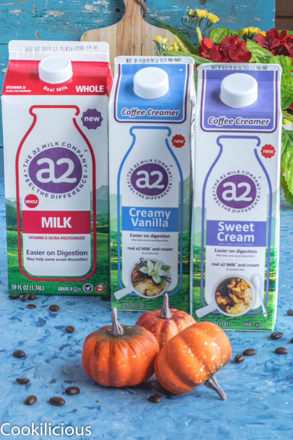 1 a2 milk carton and 2 a2 milk creamer placed next to each other