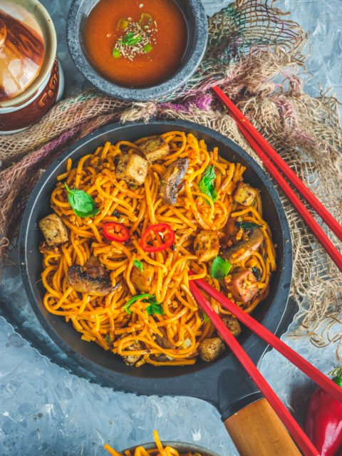 Asian Style Thai Basil Tofu Stir Fry Noodles with chopsticks in it