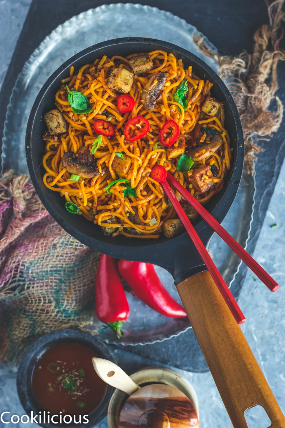 Asian Style Thai Basil Tofu Stir Fry Noodles in a pan with a set of chopsticks over it