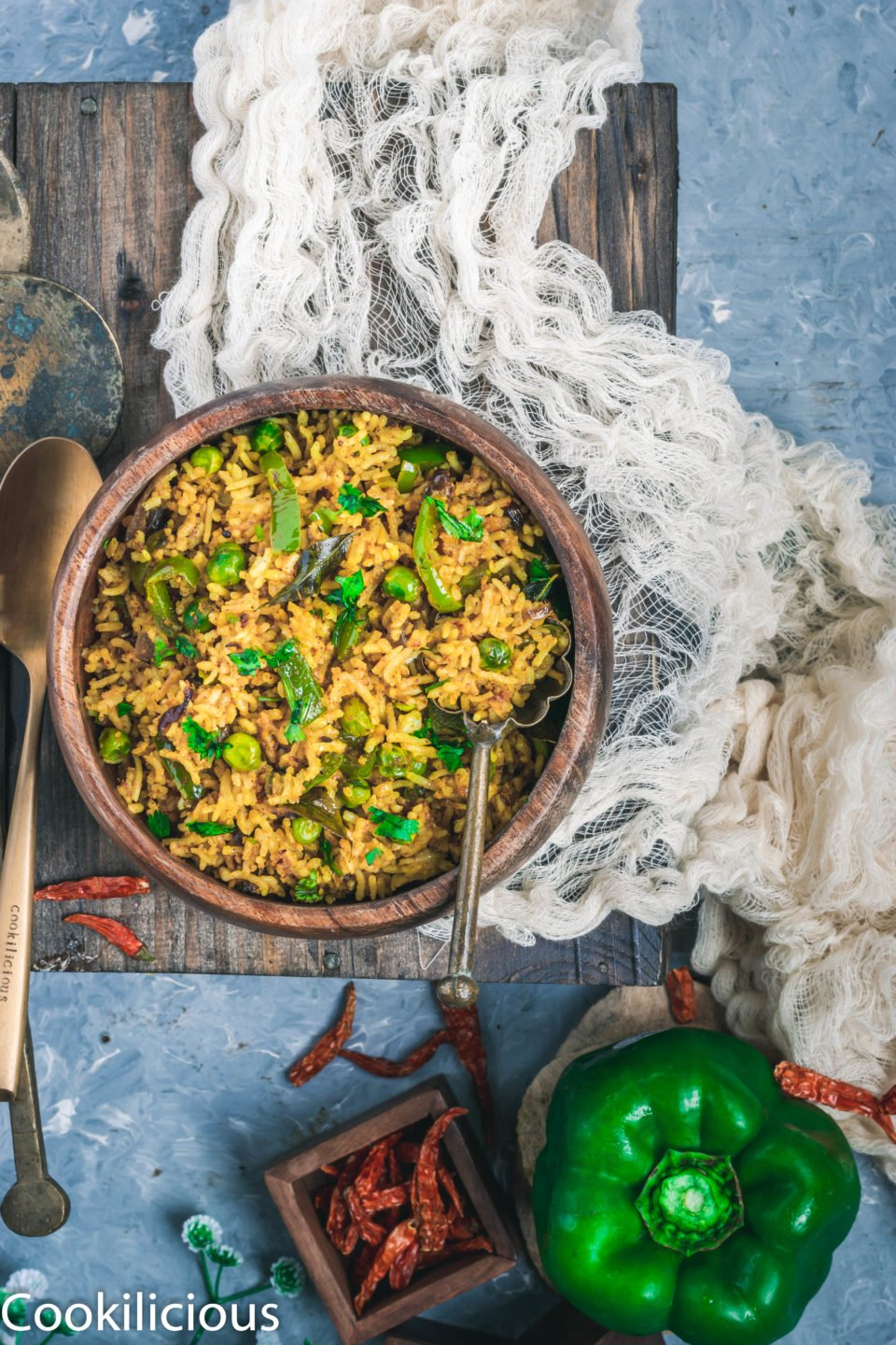 a bowl of Bell Pepper Fried Rice resting over a muslin cloth