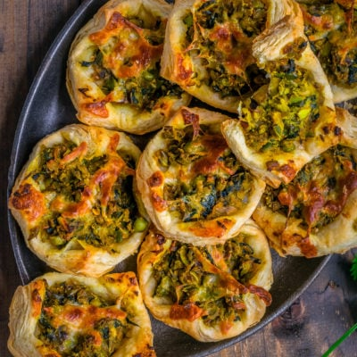 Spicy Green Peas & Spinach Pastry Puffs in an oval tray