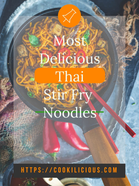 Asian Style Thai Basil Tofu Stir Fry Noodles in a pan with a set of chopsticks over it with a text overlay