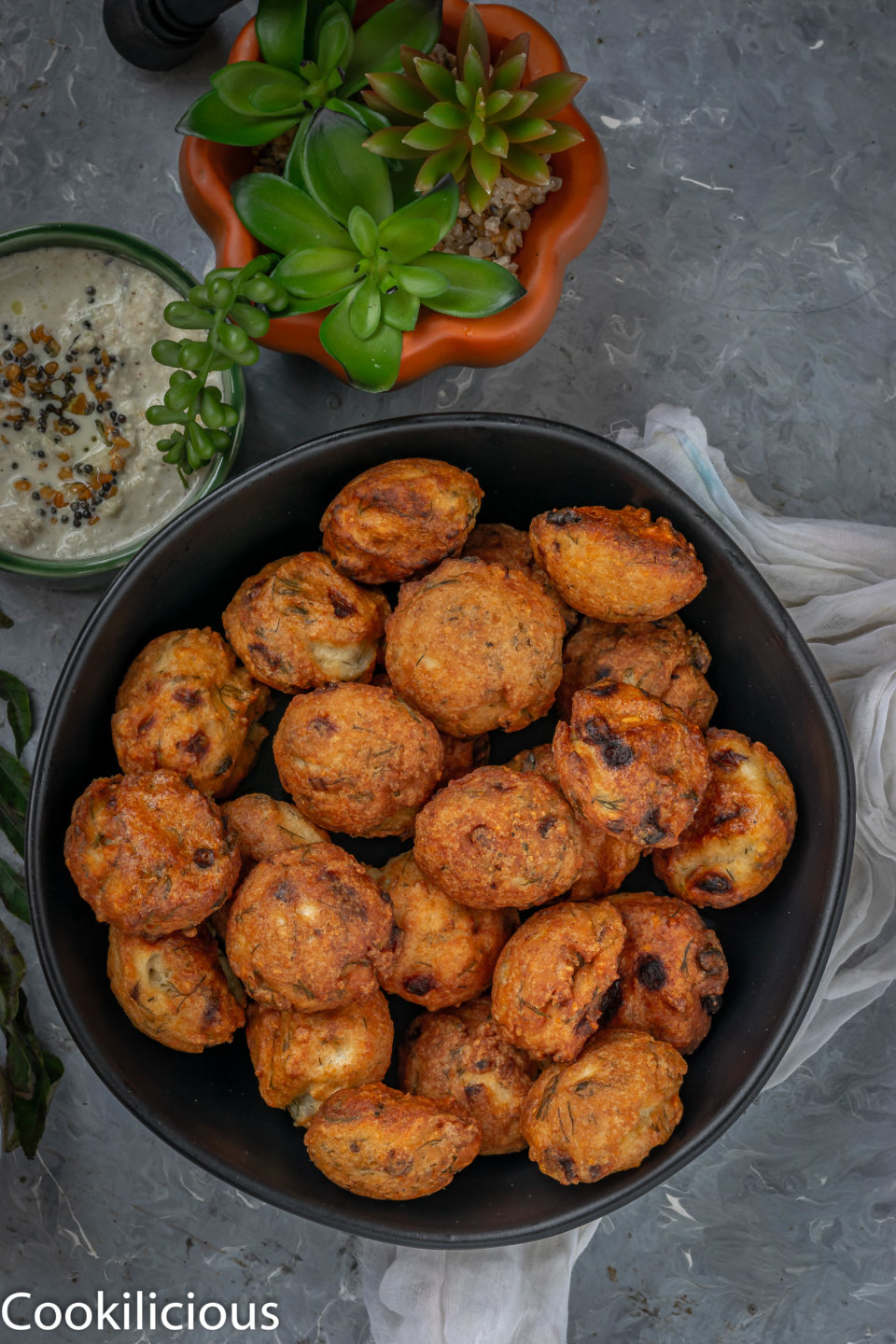 a bowl filled with Dill Flavored Lentil Fritters