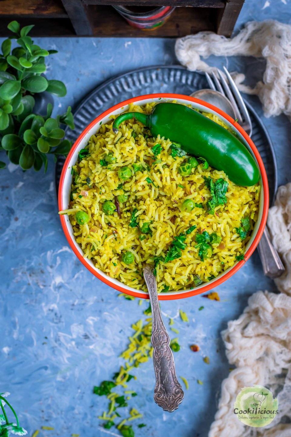 Green Peas Pulao in a bowl with a spoon in it