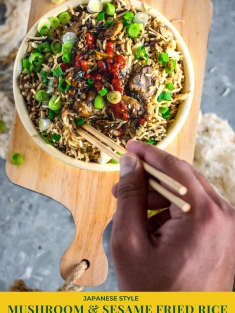 a hand holding chopsticks digging into a Japanese fried rice bowl and text at the bottom