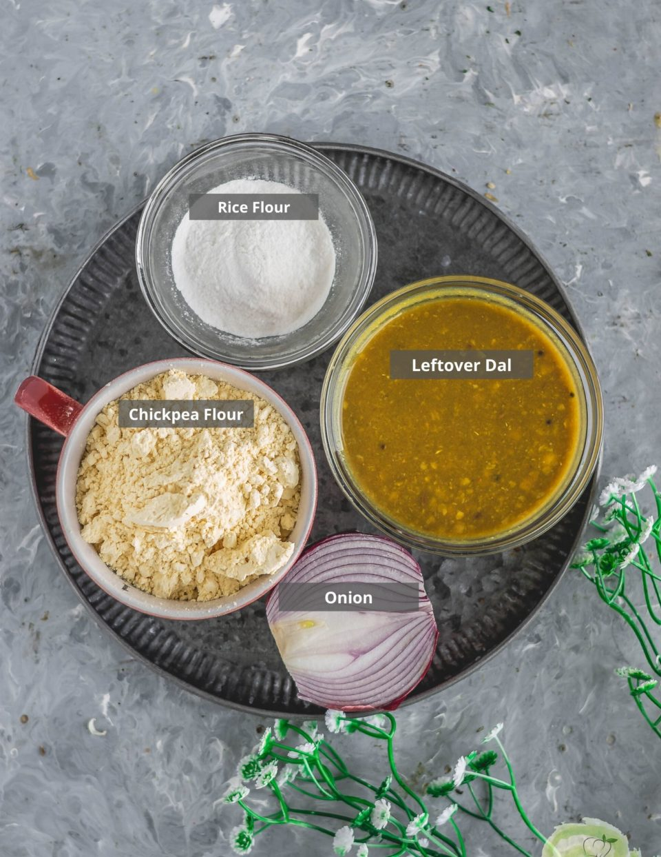 a tray featuring all the ingredients used to make Lentil Pancakes with Leftover Dal