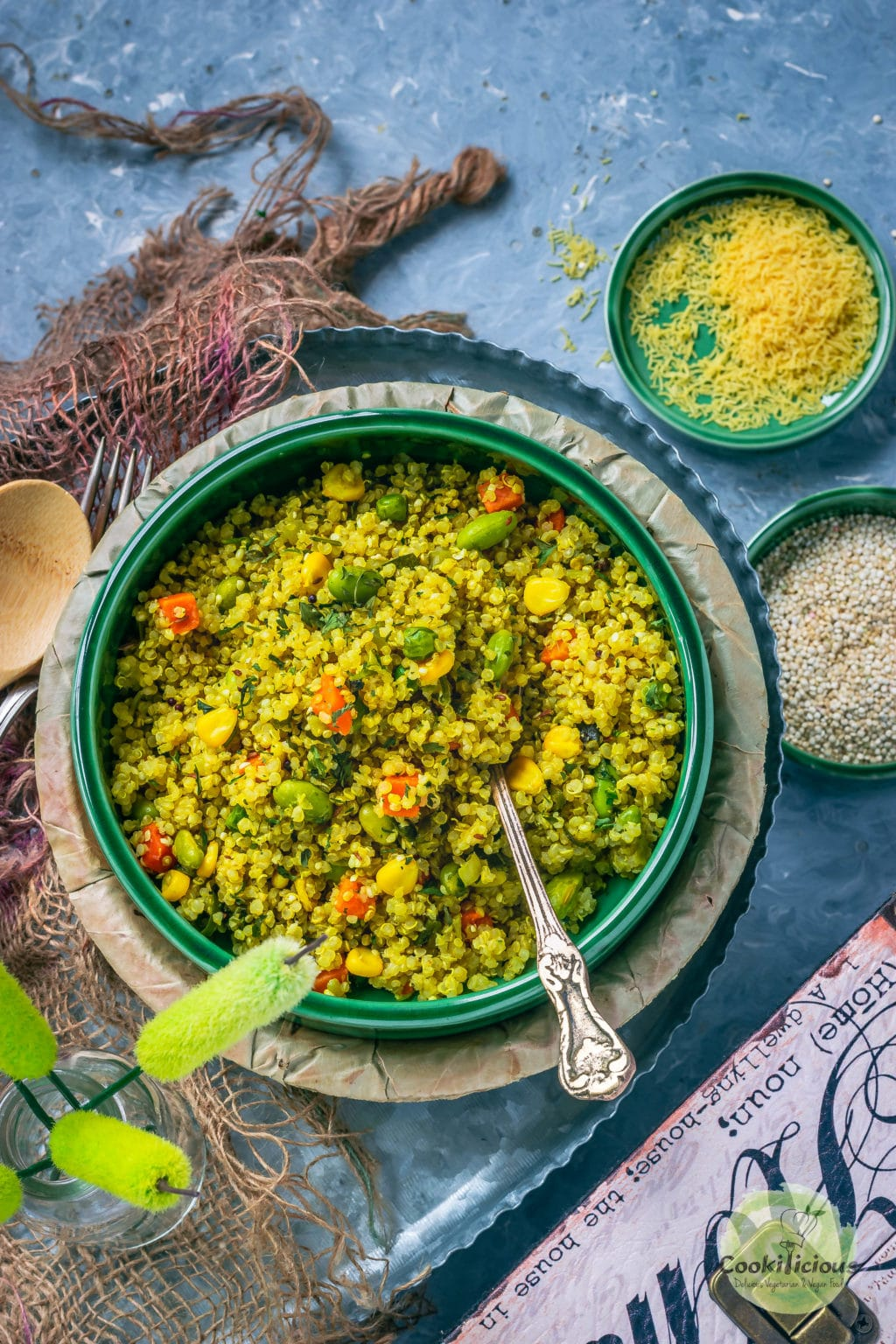 Vegetable Quinoa Upma in a bowl with a spoon in it