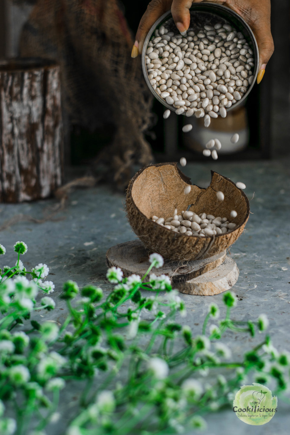 navy beans being poured into a coconut shell