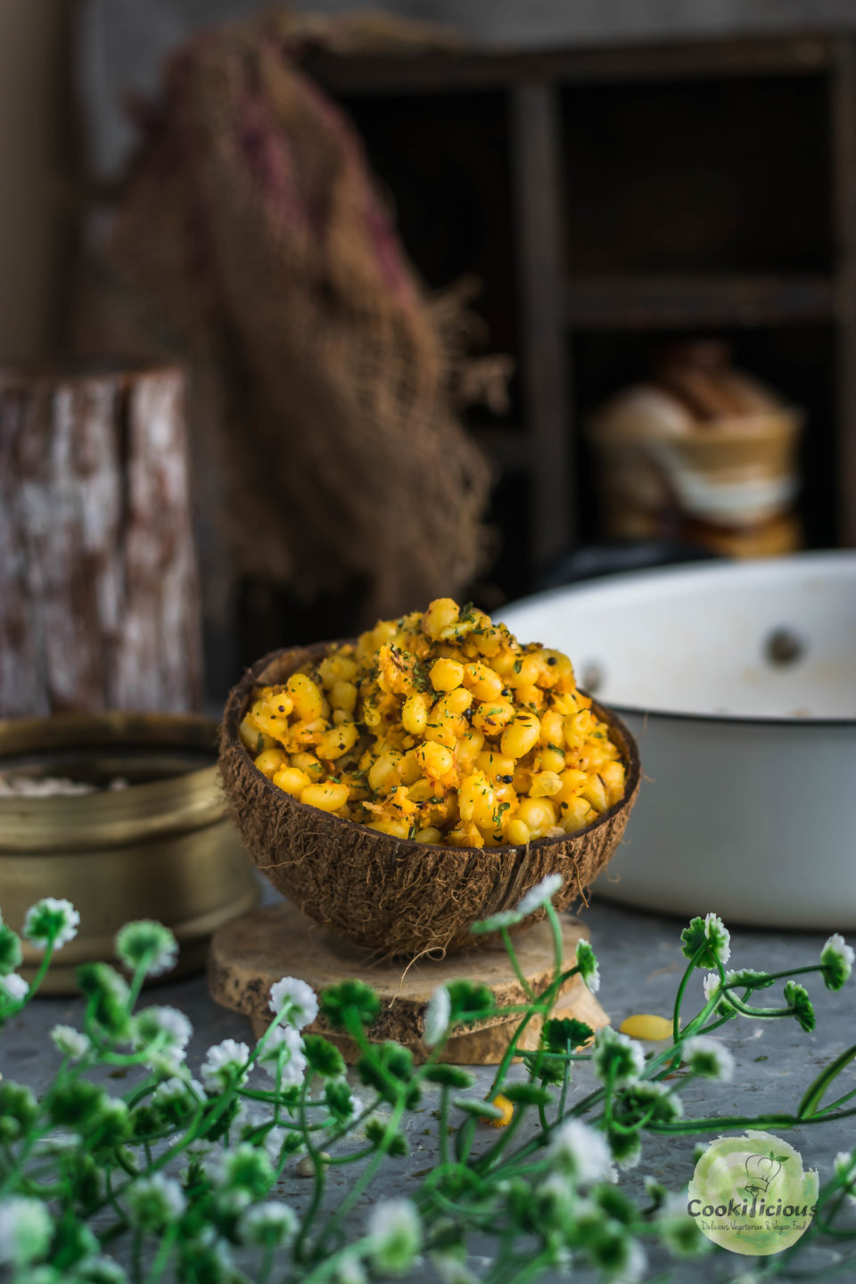 an empty coconut shell filled with this Asian snack called navy beans sundal - a vegan salad