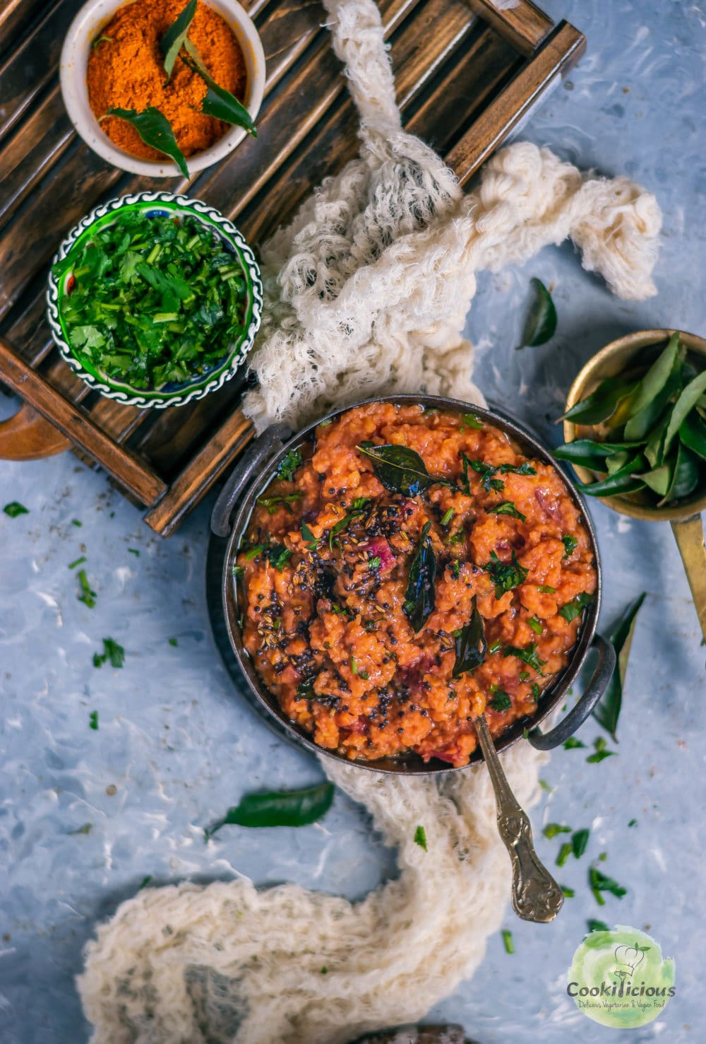 Instant Pot Beetroot Rasam Rice in a bowl with a bowl of dried cilantro on the side