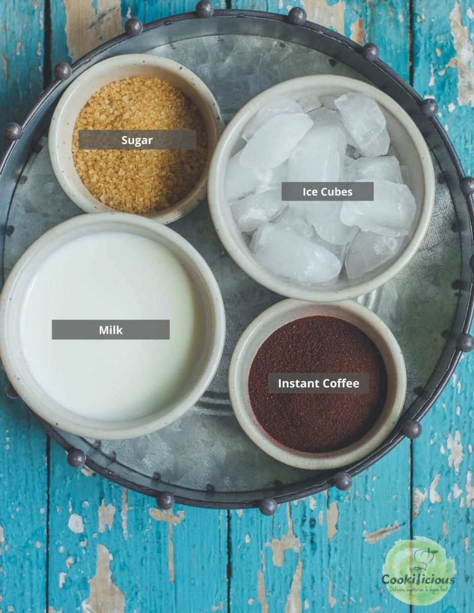 a round tray containing all the ingredients needed to make Dairy Free Dalgona Coffee