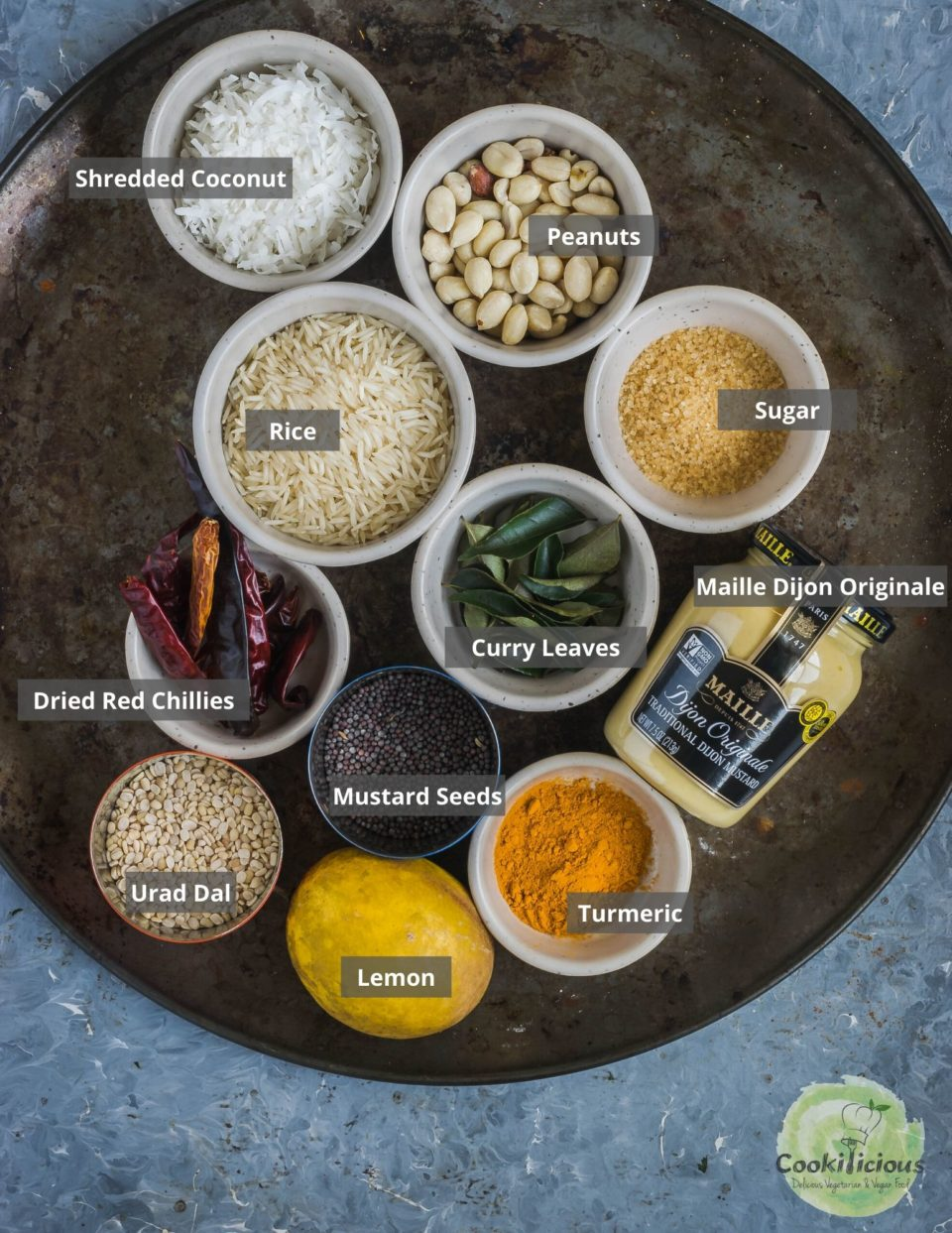 all the ingredients needed to make Coconut Mustard Rice placed in a round tray